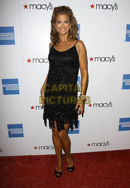 KATHY IRELAND. 27th Annual Macy's Passport Fashion Show Benefit - Arrivals held At Barker Hangar, Santa Monica, California, USA..September 24th, 2009.full length black dress beads beaded .CAP/ADM/KB.©Kevan Brooks/AdMedia/Capital Pictures.