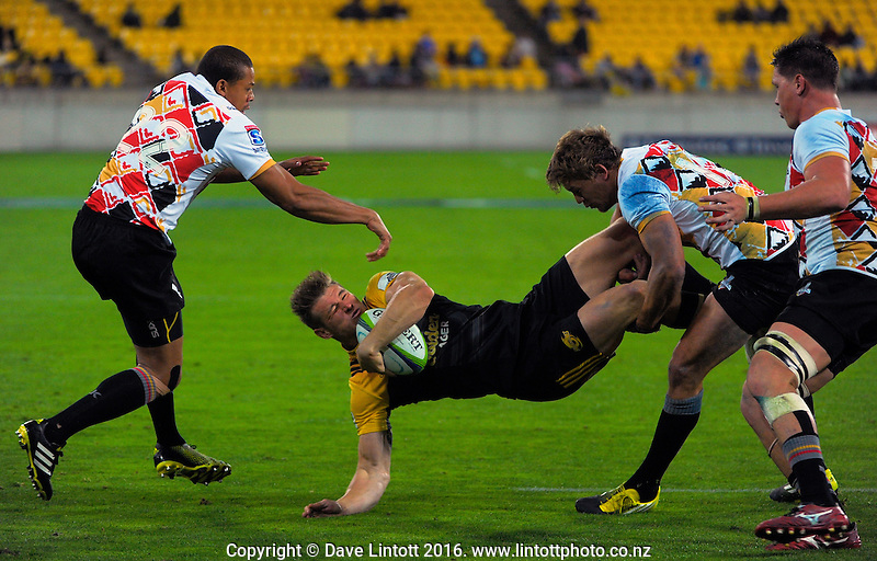 Jason Woodward is tackled during the Super Rugby match between the Hurricanes and Southern Kings at Westpac Stadium, Wellington, New Zealand on Friday, 25 March 2016. Photo: Dave Lintott / lintottphoto.co.nz