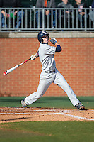 Ryan Miller (7) of the Florida Atlantic Owls follows through on his swing against the Charlotte 49ers at Hayes Stadium on March 14, 2015 in Charlotte, North Carolina.  The Owls defeated the 49ers 8-3 in game one of a double header.  (Brian Westerholt/Four Seam Images)