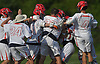 Hills East varsity boys lacrosse teammates celebrate their 11-9 win over Commack in the Suffolk County Division I (Class A) quarterfinals at Half Hollow Hills High School East on Friday, May 19, 2017.