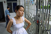 Ah Li, a 21 year-old female drug addict looks sad when leaving the drug rehabilitation centre in Bao'an, after recovering from serious drug addiction. Ah Li moved to Shenzhen from northern China when just sixteen years old after the break-up of her family. She was tricked into prostitution and initially forced to take drugs until she became addicted and dependent on her gang bosses.