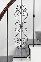 One of the Georgian inspired, understated wrought-iron banisters on the main staircase