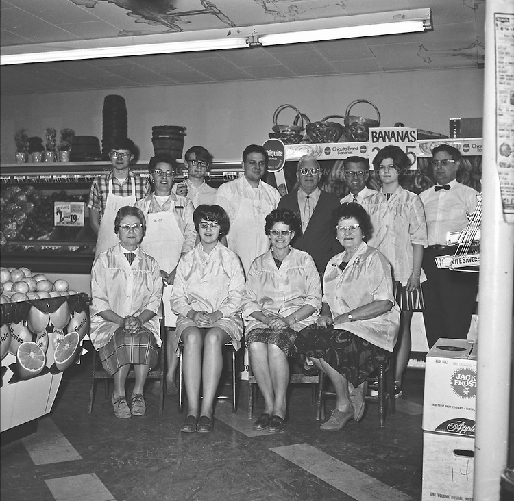 "Hi Lo Employees. March 1969<br /> -L to R Back row: Larry Hinzman, Jim Mueller, Steve Boyer, Don Mueller, J. Hopper<br /> -L to R Middle row: Ferne (Mrs. James, ""Duke"") Halls, John E Mueller, Peggy  Pfailer<br /> -L to R Front row seated: Lena Wergin, Ruth McDill, Florence Mueller Huxford, Pearl Worden"