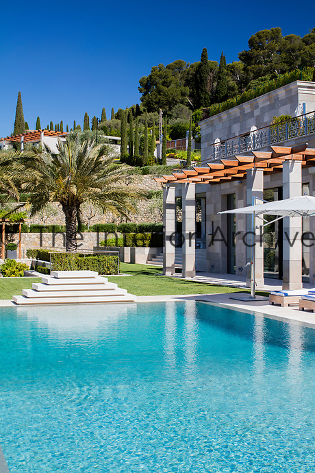 The villa incorporates a large loggia that overlooks the pool.