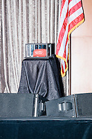 """A """"Make America Great Again"""" hat rests in a display case on stage in the ballroom at the Midtown Hilton Hotel in New York, New York, on the morning of election day, Tues., Nov. 8, 2016. Republican nominee Donald Trump held his election night rally at the hotel."""