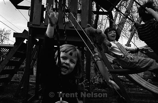 Noah Nelson, Jaime Hutchison, Anna Hutchison, Nathaniel Nelson on the swings. 03/10/2003<br />