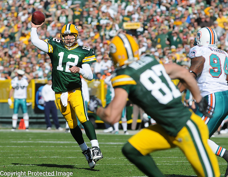 Green Bay Packers quarterback Aaron Rodgers, left, throwns incomplete to Jordy Nelson against the Miami Dolphins during the fourth quarter of the game at Lambeau Field in Green Bay, Wis., on Oct. 17, 2010.