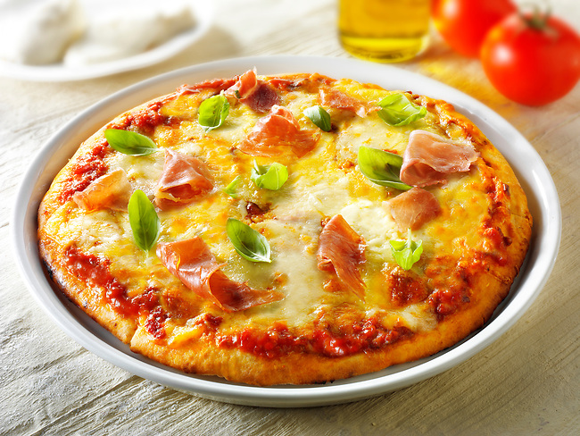 Pizza topped with  3 cheeses, Parma ham & basil photos. Funky Stock pizzas photos