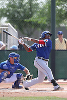 Chris Grayson #18 of the Texas Rangers bats during a Minor League Spring Training Game against the Kansas City Royals at the Kansas City Royals Spring Training Complex on March 20, 2014 in Surprise, Arizona. (Larry Goren/Four Seam Images)