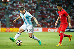 Eduardo Salvio of Argentina (L) dribles Hafiz Sujad of Singapore (R) during the International Test match between Argentina and Singapore at National Stadium on June 13, 2017 in Singapore. Photo by Marcio Rodrigo Machado / Power Sport Images