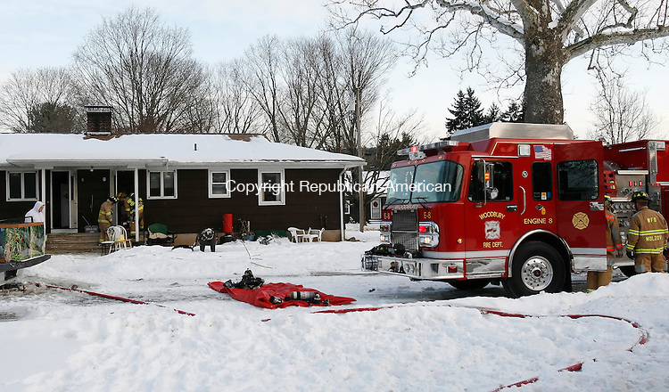 WOODBURY, CT, 01/21/08- 012109BZ03- Woodbury Volunteer firefighters at the scene of a house fire on Linden Road Wednesday.<br />  Jamison C. Bazinet Republican-American