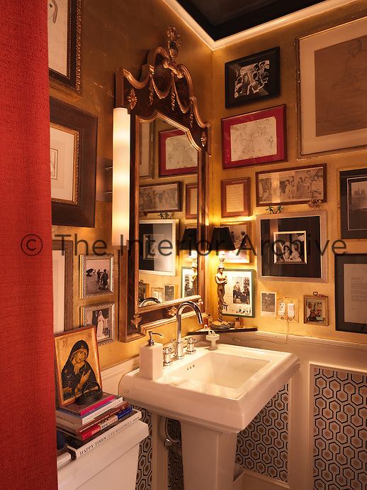 A warm, intimate and glamorous bathroom lined with gold leaf