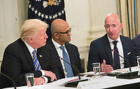 United States President Donald J. Trump (left) participates in an American Technology Council roundtable with corporate and eduction leaders including Microsoft CEO Satya Narayan (center) and Amazon CEO Jeff Bezos (right) at The White House in Washington, DC, June 19, 2017. Credit: Chris Kleponis / CNP /MediaPunch