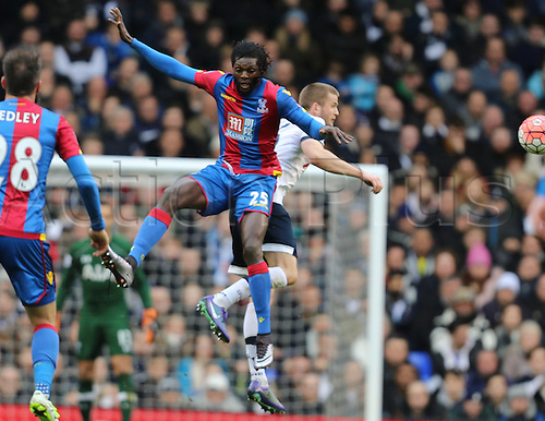 21.02.2016. White Hart Lane, London, England. Emirates FA Cup 5th Round. Tottenham Hotspur versus Crystal Palace. Emmanuel Adebayor jumps for the ball with Eric Dier
