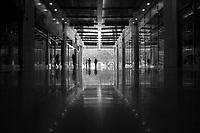 Silhouette Of Two People Walking In A Mall Hallway On Nanping West Road in Nan'an, Chongqing, China.  © LAN