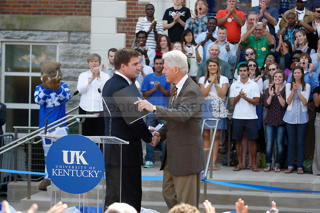 President Bill Clinton shakes hands with Jack Conway at the University of Kentucky on Monday, October 11, 2010.  Photo by Latara Appleby | Staff