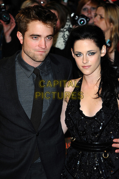 Robert Pattinson, Kristen Stewart.'The Twilight Saga: Breaking Dawn - Part 1' UK film premiere at Westfield Stratford City, London, England..16th November 2011.half length rob grey gray suit jacket black dress belt sequins sequined couple stubble facial hair.CAP/CJ.©Chris Joseph/Capital Pictures.