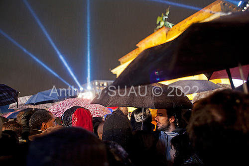 Berlin, Germany<br /> November 9, 2009<br /> <br /> The final event at the Brandenbuger Gate, with a show and the tumbling of a massive domino wall placed from the Brandenburger Tor to Potsdamer Platz in for the  20th anniversary of the fall of the Berlin Wall. Rain may have held much of the crowd back but thousand showed up to celebrate from all over Europe.