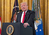 United States President Donald J. Trump makes remarks as he awards the Medal of Honor posthumously to Technical Sergeant John A. Chapman, US Air Force, during a ceremony in the East Room of the White House in Washington, DC on Wednesday, August 22, 2018.  Sergeant Chapman is being honored for his actions on March 4, 2002, on Takur Ghar mountain in Afghanistan where he gave his life to save his teammates.<br /> Credit: Ron Sachs / CNP