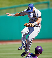 Koby Kraemer (5) of the Indiana State Sycamores leaps over a base runner to catch a high thrown ball during a game against the Evansville Purple Aces in the 2012 Missouri Valley Conference Championship Tournament at Hammons Field on May 23, 2012 in Springfield, Missouri. (David Welker/Four Seam Images).