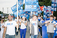Supporters of Democratic presidential candidate Joe Biden march in the Labor Day Parade in Milford, New Hampshire, on Mon., September 2, 2019. Candidates Bernie Sanders and Vermin Supreme were the only candidates who marched in the parade this year.