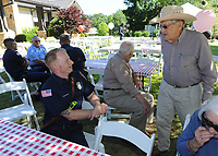 NWA Democrat-Gazette/ANDY SHUPE<br /> Bill Bequette (right), a resident at Butterfield Trail Village, speaks Thursday, May 25, 2017, with Carl Braach, a firefighter with the Fayetteville Fire Department during a cookout for local police, fire and emergency responders at Butterfield Trail Village in Fayetteville. The facility hosts a similar event annually in appreciation for all that local emergency organizations do for residents.