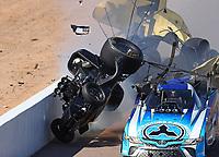 Feb 25, 2018; Chandler, AZ, USA; NHRA funny car driver John Force (left) crashes with Jonnie Lindberg during the Arizona Nationals at Wild Horse Pass Motorsports Park. Mandatory Credit: Mark J. Rebilas-USA TODAY Sports