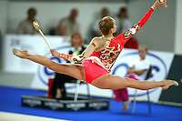September 21, 2007; Patras, Greece;  Inna Zhukova of Belarus split leaps to re-catch clubs during the All-Around final at 2007 World Championships Patras.  Inna placed 4th in the AA to qualify Belarus for 1st of 2 positions in the individual All-Around competition at Beijing 2008 and the possibility of making her 2nd Olympic Games.  Photo by Tom Theobald. .