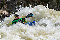 An expert kayaker adroitly negotiates the giant waves of the Upper Payette River near Boise Idaho.