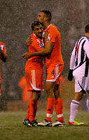 Pictured L-R: Team mates Neil Taylor and Steven Caulker of Swansea congratulate each other after the final whistle. Saturday, 04 February 2012<br />
