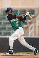 Juan Ciriaco (35) of the Augusta GreenJackets follows through on his swing at Fieldcrest Cannon Stadium in Kannapolis, NC, Wednesday August 20, 2008. (Photo by Brian Westerholt / Four Seam Images)