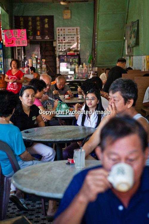 Customers eat breakfast at local kopitiam (traditional Chinese breakfast and coffee shop) in capital Georgetown of Penang in Malaysia. Photo: Sanjit Das/Panos