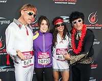 LAS VEGAS, NV - December 2 : Nikki Reed with Elvis Impersonator Runners pictured at Rock and Roll Marathon & 1/2 on The Las Vegas Strip at Night on December 2, 2012 in Las Vegas, Nevada. © Kabik/ Starlitepics /MediaPunch Inc. ©/NortePhoto /NortePhoto©