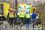 Killarney firemen cut the passengers out of the Ford Escort that was involed in a crash that kept the Killarney to Kilgarvan road closed for two hours on Thursday   Copyright Kerry's Eye 2008