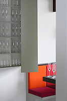 Detail of a wall-mounted cupboard in the dining room used for storing glassware