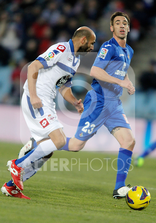 Getafe's Borja Fernandez against Deportivo de La Coruna's Manuel Pablo during La Liga match. February 01, 2013. (ALTERPHOTOS/Alvaro Hernandez)