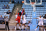 13 November 2015: Gardner-Webb's Aunesha Williams (5) shoots over North Carolina's Erika Johnson (31) and Stephanie Watts (left). The University of North Carolina Tar Heels hosted the Gardner-Webb University Runnin' Bulldogs at Carmichael Arena in Chapel Hill, North Carolina in a 2015-16 NCAA Division I Women's Basketball game. Gardner-Webb won the game 66-65.