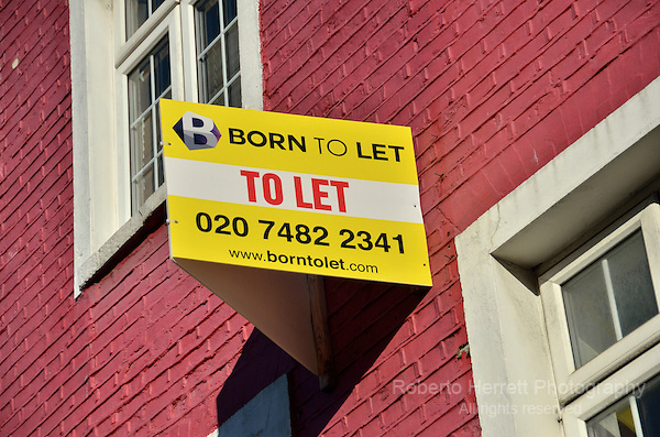 To Let estate agent board outside a first floor flat, London, UK.