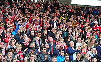 Lincoln City fans celebrate the late victory<br /> <br /> Photographer Andrew Vaughan/CameraSport<br /> <br /> Vanarama National League - Gateshead v Lincoln City - Monday 17th April 2017 - Gateshead International Stadium - Gateshead <br /> <br /> World Copyright &copy; 2017 CameraSport. All rights reserved. 43 Linden Ave. Countesthorpe. Leicester. England. LE8 5PG - Tel: +44 (0) 116 277 4147 - admin@camerasport.com - www.camerasport.com