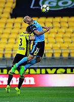 Adrian Mierzejewski goes up for a header under pressure from Scott Galloway during the A-League football match between Wellington Phoenix and Sydney FC at Westpac Stadium in Wellington, New Zealand on Saturday, 23 December 2017. Photo: Dave Lintott / lintottphoto.co.nz