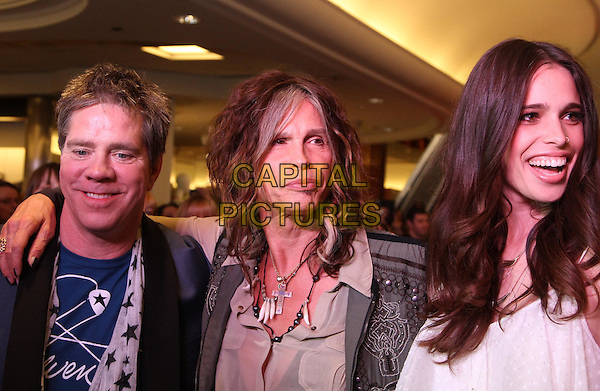 Andy Hilfiger, Steven Tyler and Chelsea Tyler.Steven Tyler & Andy Hilfiger host Andrew Charles' Fashion Show,  Macy's, Sherman Oaks, California, USA..April 7th, 2012.headshot portrait beige shirt waistcoat grey gray father dad daughter family.CAP/ADM/KB.©Kevan Brooks/AdMedia/Capital Pictures.