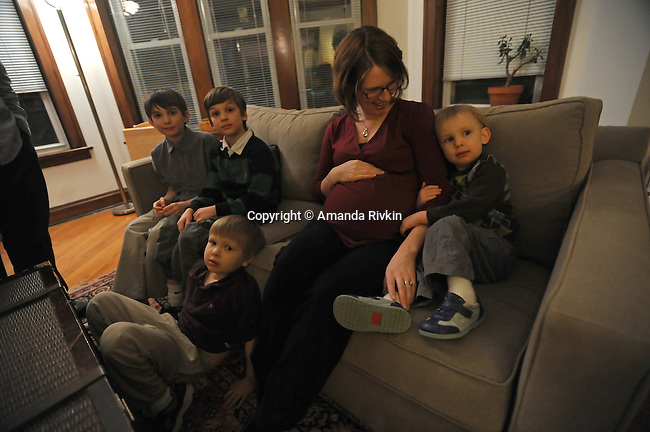Meagan Francis, 31, with her four children (l-r) Jacob Dodson, 11, Isaac Dodson, 9, William Dodson, 5, and Owen Dodson, 3, at the home of one of her husband's colleagues in Evanston, Illinois on February 4, 2009.  Francis is pregnant with her fifth child.