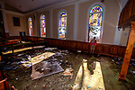 PORT SAINT JOE, FL - OCTOBER 14: Pastor Geoffrey Lentz looks out at St Joe Bay from his sanctuary of the First United Methodist Church after it was gutted by the storm surge from Hurricane Michael on October 14, 2018 in Port Saint Joe, Florida.  The surge took out the bottom half all the stain glass windows.  (Photo by Mark Wallheiser/Getty Images)