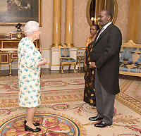 14 June 2017 - Queen Elizabeth II is presented with the Letters of Recall of his predecessor and his own Letters of Credence by His Excellency Ernest Ndabashinze, the Ambassador from the Republic of Burundi, as Mrs Maria Gloriose Kankindi looks on, during a private audience in Buckingham Palace, central London. Photo Credit: ALPR/AdMedia