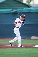 Orem Owlz right fielder Rayneldy Rosario (12) celebrates after getting a hit during a Pioneer League game against the Ogden Raptors at Home of the OWLZ on August 24, 2018 in Orem, Utah. The Ogden Raptors defeated the Orem Owlz by a score of 13-5. (Zachary Lucy/Four Seam Images)