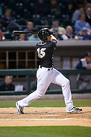 Trayce Thompson (15) of the Charlotte Knights follows through on his swing against the Toledo Mud Hens at BB&T BallPark on April 27, 2015 in Charlotte, North Carolina.  The Knights defeated the Mud Hens 7-6 in 10 innings.   (Brian Westerholt/Four Seam Images)