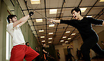Sam Krey, left, and Michel Cohen, a senior and junior in The Theatre School, practice sword fighting techniques during their Stage Combat class, Thursday, Jan. 21, 2016. In the class, students learn the fundamentals of hand-to-hand combat and weaponry with a focus on developing skills safely and effectively for the stage. (DePaul University/Jeff Carrion)