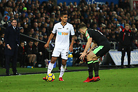 Swansea City manager Paul Clement and Bournemouth manager Eddie Howe watch on as Kyle Naughton of Swansea City is marked by Marc Pugh of Bournemouth during the Premier League match between Swansea City and Bournemouth at the Liberty Stadium, Swansea, Wales, UK. Saturday 25 November 2017