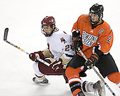 Matt Lombardi 24 of Boston College and Michael Hodgson 2 of Bowling Green fight for position. The Eagles of Boston College defeated the Falcons of Bowling Green State University 5-1 on Saturday, October 21, 2006, at Kelley Rink of Conte Forum in Chestnut Hill, Massachusetts.<br />