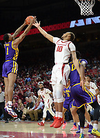 NWA Democrat-Gazette/ANDY SHUPE<br /> Arkansas forward Daniel Gafford (10) and LSU guard Ja'Vonte Smart reach to pull down a rebound Friday, Jan. 11, 2019, during the first half of play in Bud Walton Arena in Fayetteville. Visit nwadg.com/photos to see more photographs from the game.